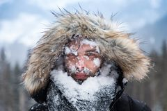Man`s face covered with snow royalty free stock photos