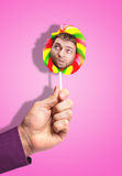 Man's face in lollipop Royalty Free Stock Images