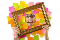 Man's face through paper and reminders Royalty Free Stock Images