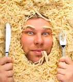 Man's face in pasta, closeup Royalty Free Stock Images