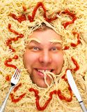 Man's face in pasta, closeup Royalty Free Stock Photos