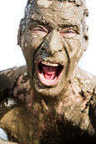 Man's face is very dirty in the mud Stock Photo