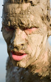 Man's face is very dirty in the mud Royalty Free Stock Photo