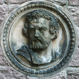 Man's face on the wall. Architectural Detail stone relief sculpture royalty free stock photos