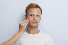 Man's facial cosmetic treatment. Royalty Free Stock Images