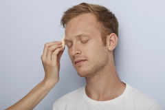 Man's facial cosmetic treatment. Stock Photography