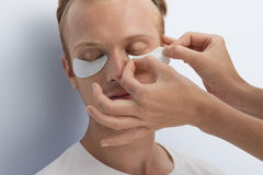 Man's facial cosmetic treatment. Stock Photo