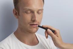 Man's facial cosmetic treatment. Royalty Free Stock Photo