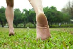 Man's feet. Running on the grass Stock Photo