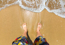 Man's feet on the beach Royalty Free Stock Photography