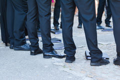 Man`s feet. Man`s feet in black trousers and black shoes royalty free stock photo