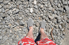 Man's feet in checkered shoes Stock Photo