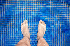 Man's Feet At Pool Royalty Free Stock Photography