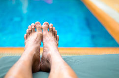 Man's Feet by Pool Royalty Free Stock Photos