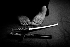 Man`s feet and ritual sword Stock Photography