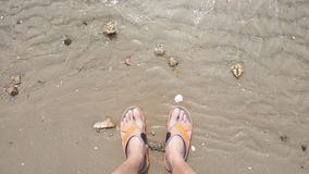 Man`s feet on the sand beach Royalty Free Stock Photos