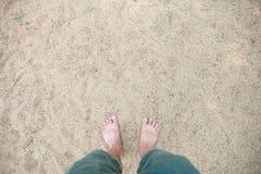 Man`s feet on sand Royalty Free Stock Image