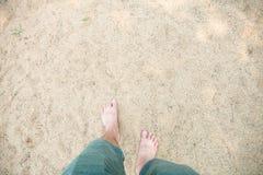 Man`s feet on sand Stock Photo