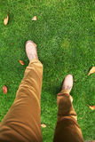 Man's feet in shoes on the grass. Walking in the park. Man's feet in shoes on the grass. Top view Royalty Free Stock Photos