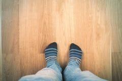 Man's feet in socks Stock Image