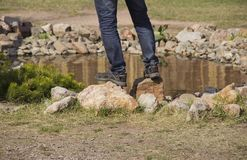 Man feet standing on the rocks stock photos