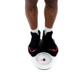 Man's feet on weighing scale Royalty Free Stock Image