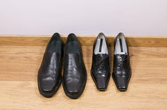 Man's and female shoes Royalty Free Stock Images