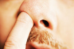 Man's finger in nose royalty free stock photos
