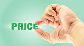 Man's Finger picking price word on green background Royalty Free Stock Images