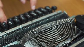 Man`s Fingers Typing The Old Metal Typewriter, Retro Style. Close-up. Man`s Fingers Typi.ng The Old Metal Typewriter, Retro Style. Close-up stock video footage