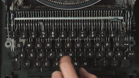 Man`s fingers typing on old retro typewriter. Man`s fingers typing on retro typewriter stock video footage
