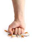 Man's fist crushing cigarettes Stock Image