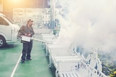 The man`s fogging to eliminate mosquito for preventing spread dengue fever and zika virus royalty free stock images