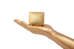 Man's golden hand holding box Stock Photo