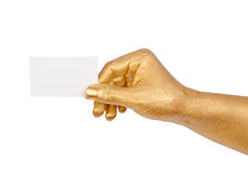 Golden hand holding an empty business card Royalty Free Stock Image