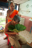 Man's hair who is going to be Buddhist monkhood. Ang Thong province, Thailand - circa August 2014 - an unidentified monk shaves on a man's hair who is going to Stock Image
