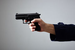 Man`s hand aiming with gun. Stock Image