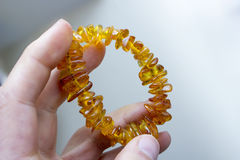 Man's hand with  amber bracelet Royalty Free Stock Images