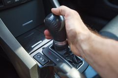 A man's hand on an automatic gearbox. Automatic shift transmission. Royalty Free Stock Photos