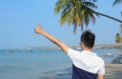 Man's hand on the beach Royalty Free Stock Photo
