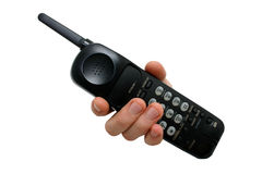 Man's Hand on Black cordless telephone Royalty Free Stock Photography
