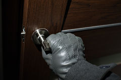 Man's hand in a black glove opening the door Royalty Free Stock Photos