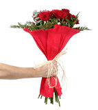 Man's hand with a bouquet of red roses Stock Images