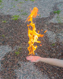 A man& x27;s hand burns with a bright flame. Royalty Free Stock Photo