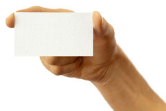 Man's hand with a business card. The hand of man shows a business card. Isolated on white royalty free stock photos