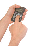 Man's hand and a calculator Stock Photos
