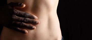 A man`s hand caressing a woman. `s belly royalty free stock photos