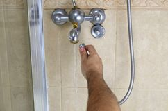 Changing shower hose royalty free stock photo