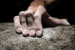 Hand holding grip. Man`s hand climbing on granite. Italian Alps Royalty Free Stock Image