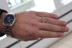Man`s hand with a clock. And ring. Wedding time. Beautiful watch. Ring is rich stock photos